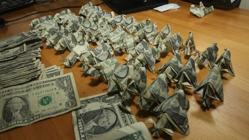 Man pays traffic ticket with dollars folded into origami pigs