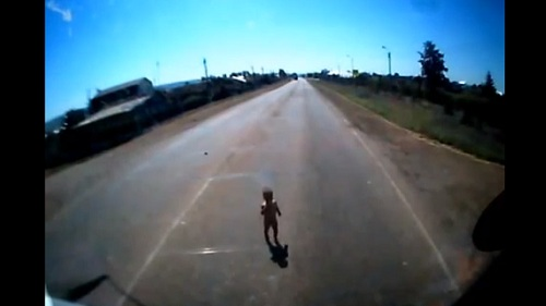Russian trucker rescues small boy