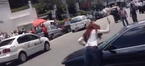 Angry woman takes out her man's car