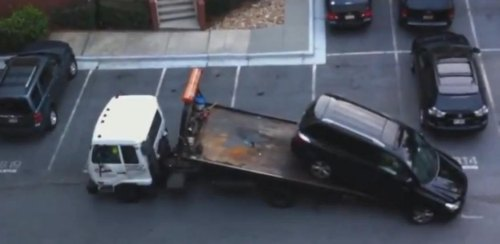 Insider Report: Watch a tow truck driver chase his machine