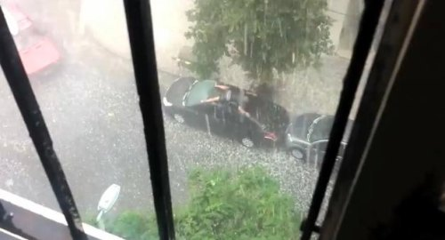Insider Report: Man tries to save car from hail by swimming on it