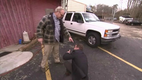Insider Report: Used car dealer punches TV reporter in the face
