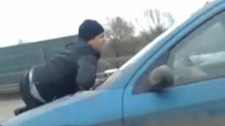 Insider Report: Man hits highway ... on the hood of a car