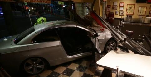 BMW smashes into Fatburger restaurant, 4 police injured