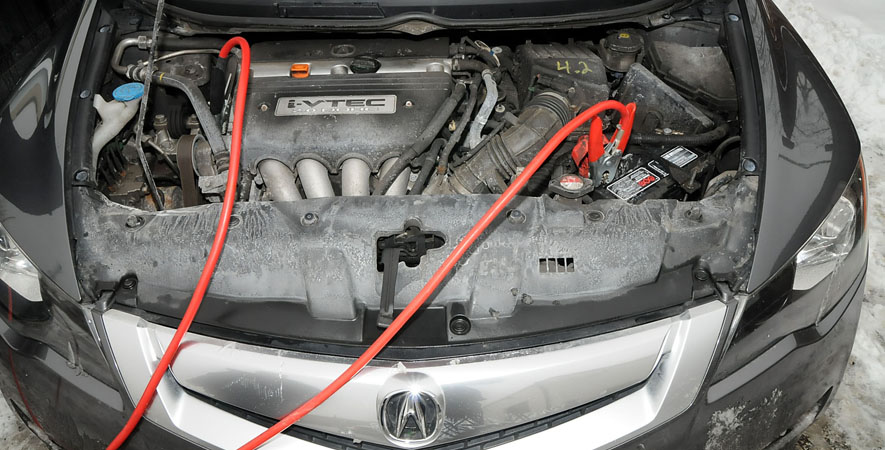 Cables attached to the car batter for a jump start