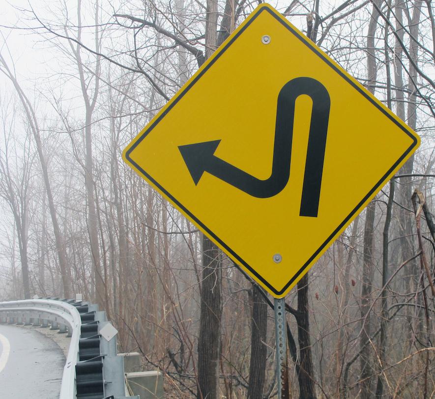 sign indicating sharp turn ahead