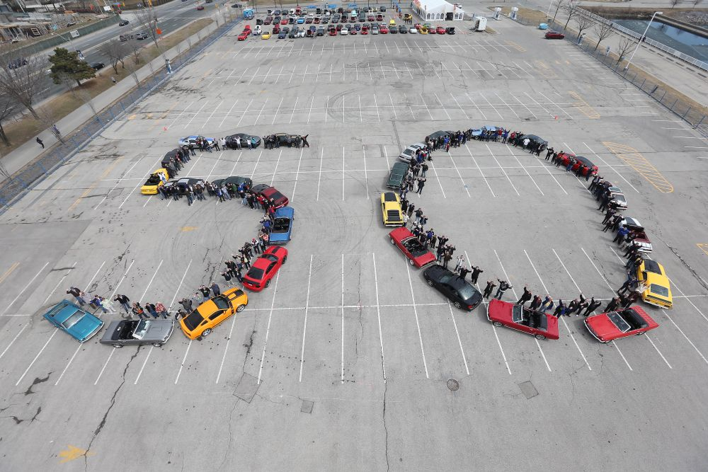 "Ford Mustang cars lined up to spell out ""50"""
