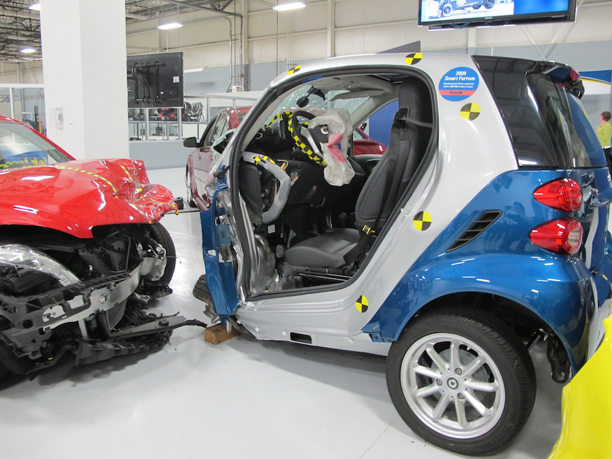 smashed smart car at IIHS