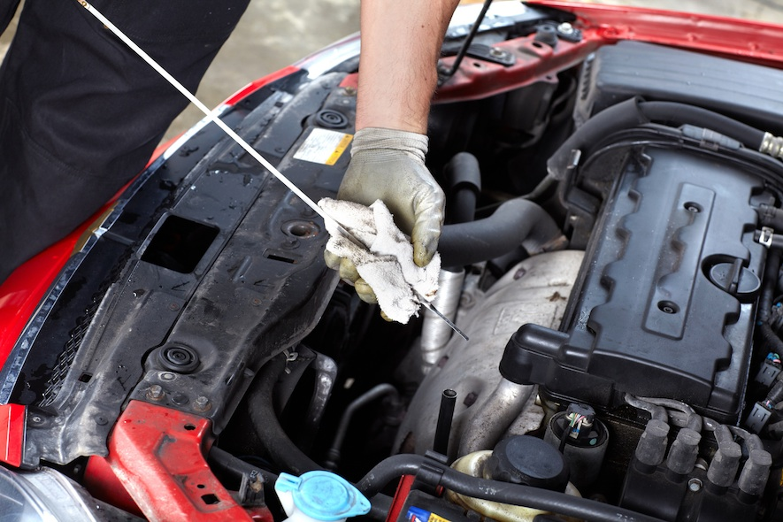 checking oil level for car maintenance