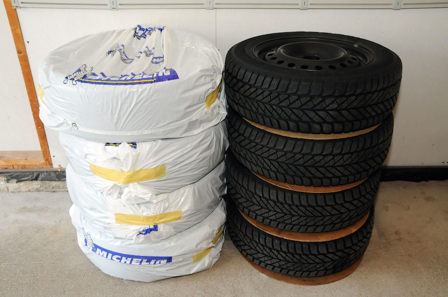 tires stacked on top of each other for winter tire storage
