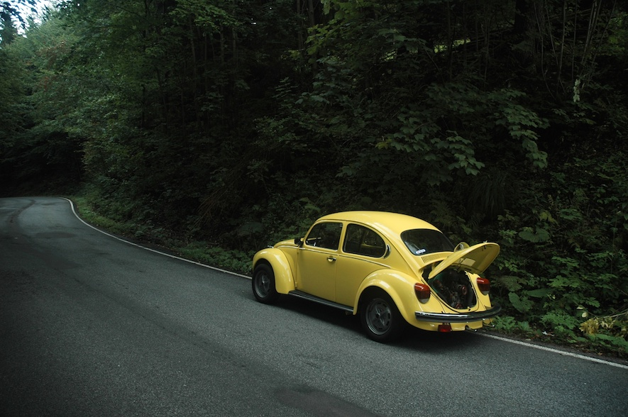 Volkswagen Beetle driving on a country road