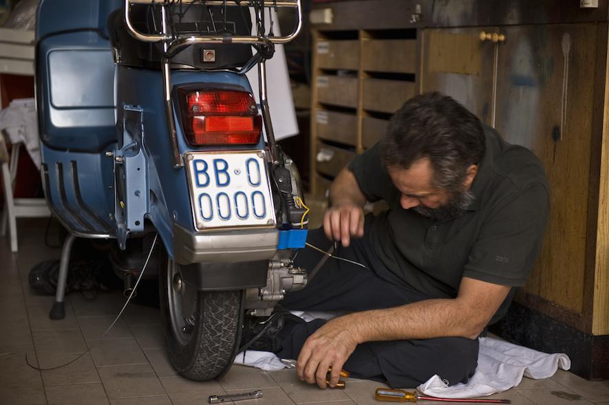 mechanic repairing a motorcycle
