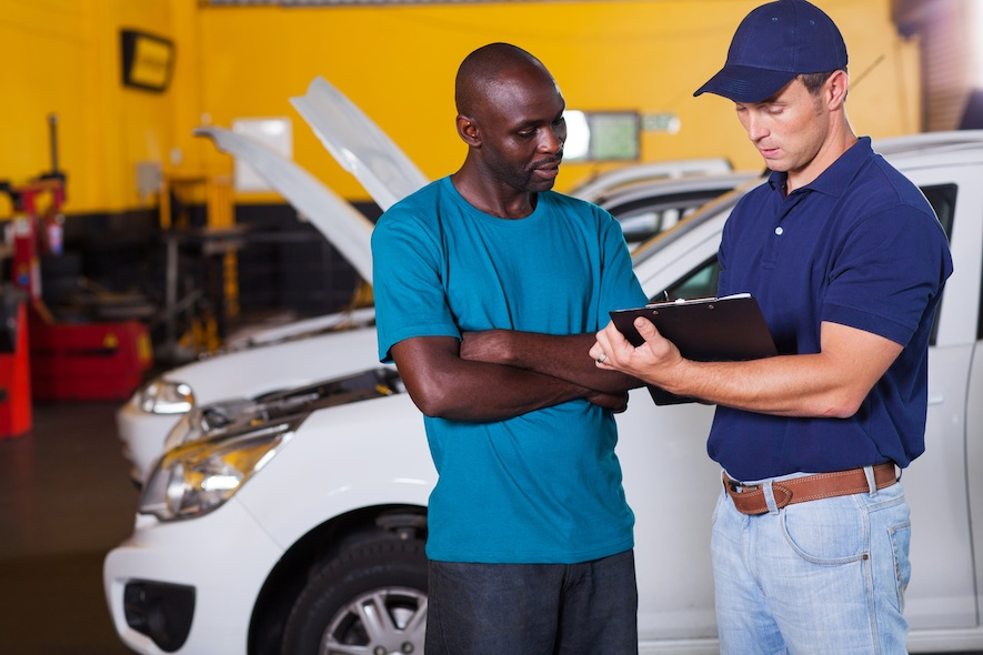 Car owner talking to auto Mechanic