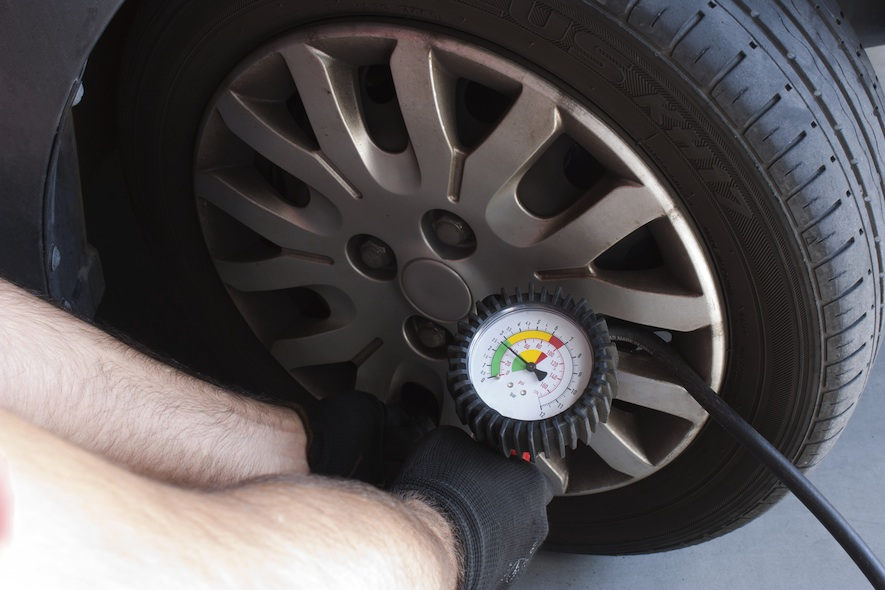 checking tire pressure for car maintenance