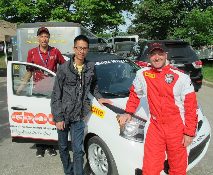 racing team in from of a nissan micra cup car