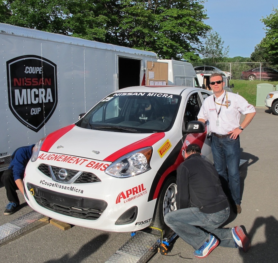 changing a tire on a nissan micra cup car