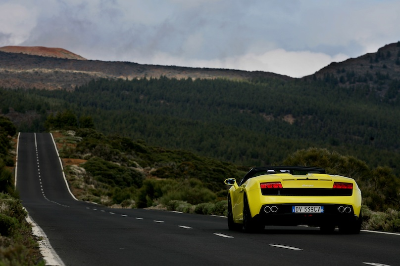 Yellow Lamborghini Gallardo on the road rear