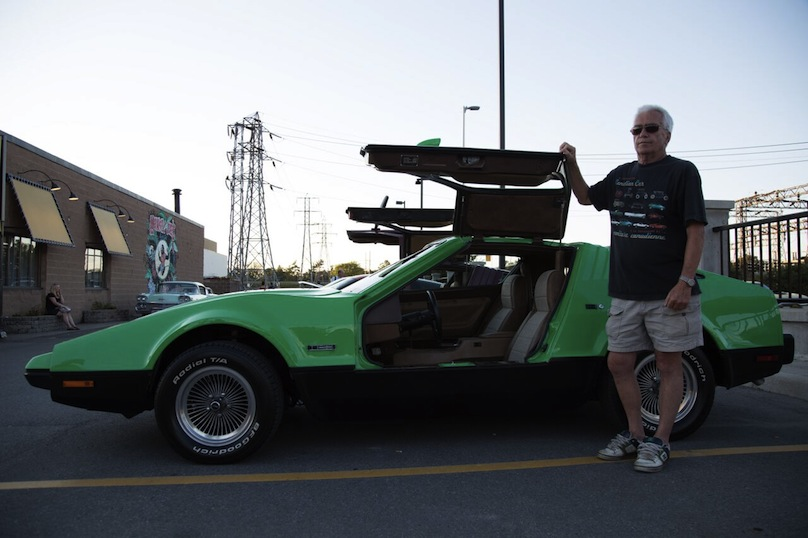 Vettoretti stand beside his DeLorean