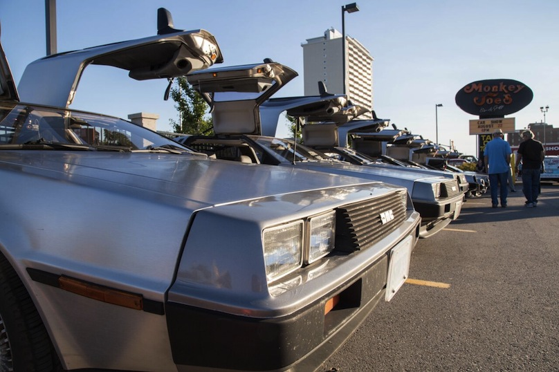 8 DeLoreans lined up in a row