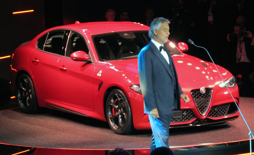 Andrea Bocelli sings in front of the Alfa Romeo Giulia at the world revewal