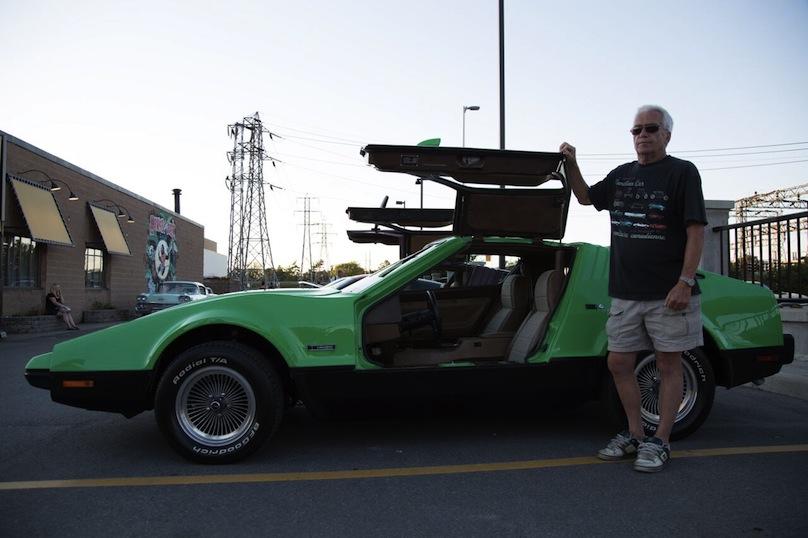 Vettoretti stand beside his DeLorean